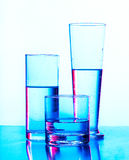 Glass of water on a blue Royalty Free Stock Images