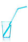 Glass of water with a blue straw Royalty Free Stock Photo