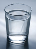 Glass of water. A glass of water with a blue tint Stock Images