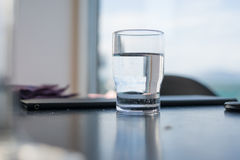 Glass of water. A glass of water with a blue tint royalty free stock images