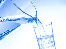 Glass of water. A glass of water in blue and white color Stock Photography