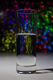 Glass with water with bokeh Royalty Free Stock Photo