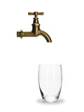 Glass for water and brass faucet Royalty Free Stock Image
