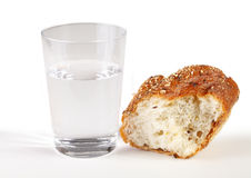 Glass of water and bread Royalty Free Stock Photography