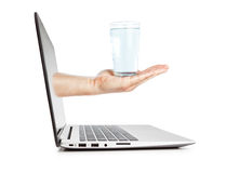 A glass of water on a break at work. Royalty Free Stock Photo