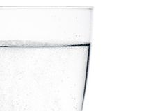 Glass with water with bubbles and space for text Royalty Free Stock Image