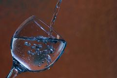 Glass with water and bubbles Royalty Free Stock Image