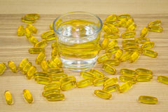 Glass of water with bunch of pills Royalty Free Stock Photo