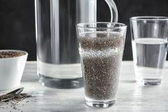 Glass of water with chia seeds. On table Royalty Free Stock Photos