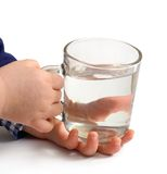 Glass of water in children hands Stock Photography