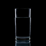 Glass water clear isolate. On over black background Stock Images