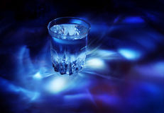 Glass with water, cold light Royalty Free Stock Photography