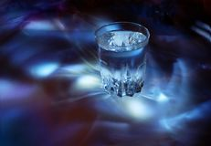 Glass with water, cold light Royalty Free Stock Images