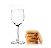 Glass of water and cookies on white background Stock Photo