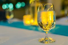 The glass of water. The glass of drinking water on the table Royalty Free Stock Photos