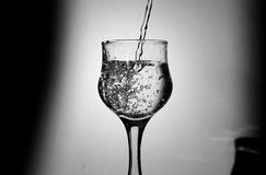 Glass of water. A glass of water with dropping water Stock Photos