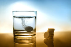 Glass of water with effervescent tablet Stock Photos