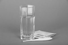 Glass with water, electronic thermometer and Stock Photos