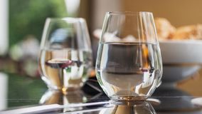 Glass of water at fancy restaurant. stock photo