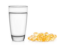 Glass of water and fish oil on white background Stock Photo