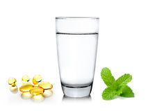 Glass of water and fish oil on white background Stock Photography