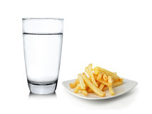 Glass of water and French fries  on white background Stock Photo