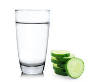 Glass of water and Fresh cucumber slice on white backgr Stock Photo
