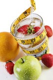 Glass of water with fruit and a tape measure Royalty Free Stock Photography