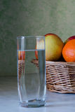 Glass of Water and Fruits Stock Image