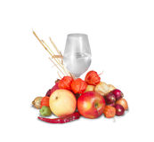 Glass of water with group of ripe fruits and vegetables Stock Photo