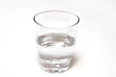 Glass of water half full or empty, isolated on white Royalty Free Stock Images