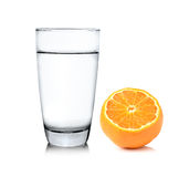 Glass of water and Half orange fruit on white background Royalty Free Stock Photos