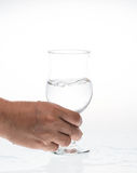 Glass of water. In hand was shaking Royalty Free Stock Image