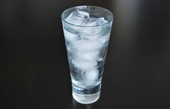 Glass of water with ice Royalty Free Stock Images