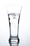 Glass with water and ice Stock Photography