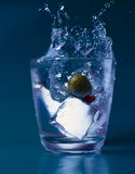 Glass with water and ice. On the blue background Royalty Free Illustration