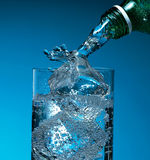 Glass with water and ice Stock Photos
