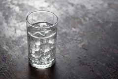 Glass of water with ice on black background.  Stock Photo