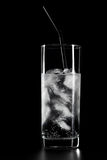 Glass of water and ice on black background Royalty Free Stock Images