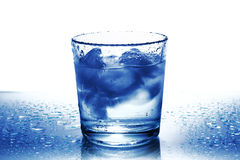 Glass of water with ice cubes Stock Photos