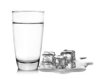 Glass of water and ice cubes on white Stock Photo