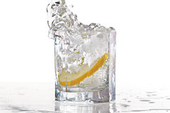 Glass of water, ice and lemon with splash Royalty Free Stock Photos