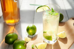 Glass of water with ice and lime Stock Images