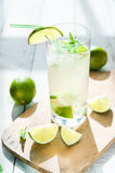 Glass of water with ice and lime Stock Photos