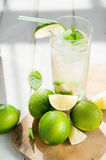 Glass of water with ice and lime Royalty Free Stock Images