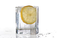Glass of water, ice and slice of fresh lemon Royalty Free Stock Photos