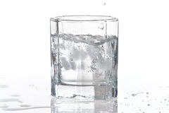 Glass of water and ice with splash Stock Photography
