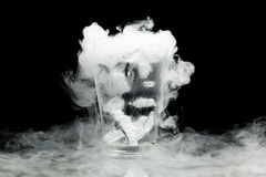 Glass of water with ice vapor Stock Image