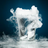 Glass of water with ice vapor Royalty Free Stock Photography