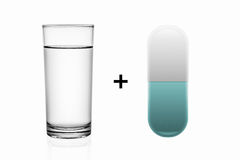 Glass of water and illustration pill isolated on white . Royalty Free Stock Images